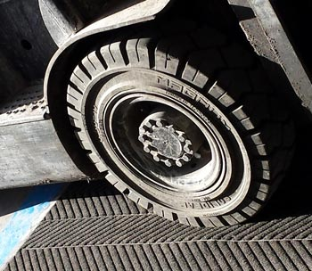Forklift Truck Wheel on Mat